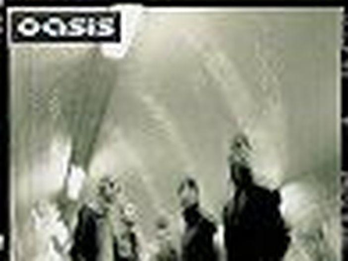 Oasis, Bonehead chiede la reunion: l'appello del chitarrista